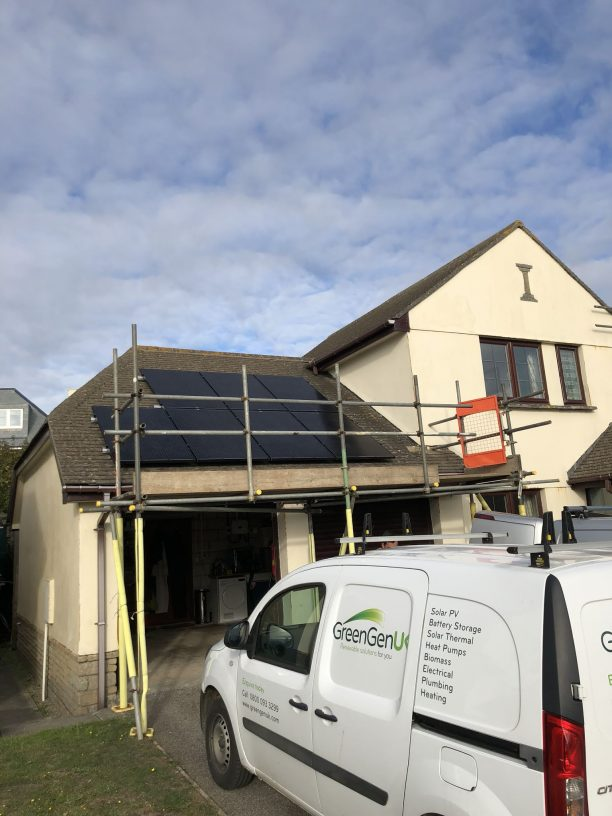 Part of a smart solar PV installation in Mullion - black solar panels on a concrete roof.