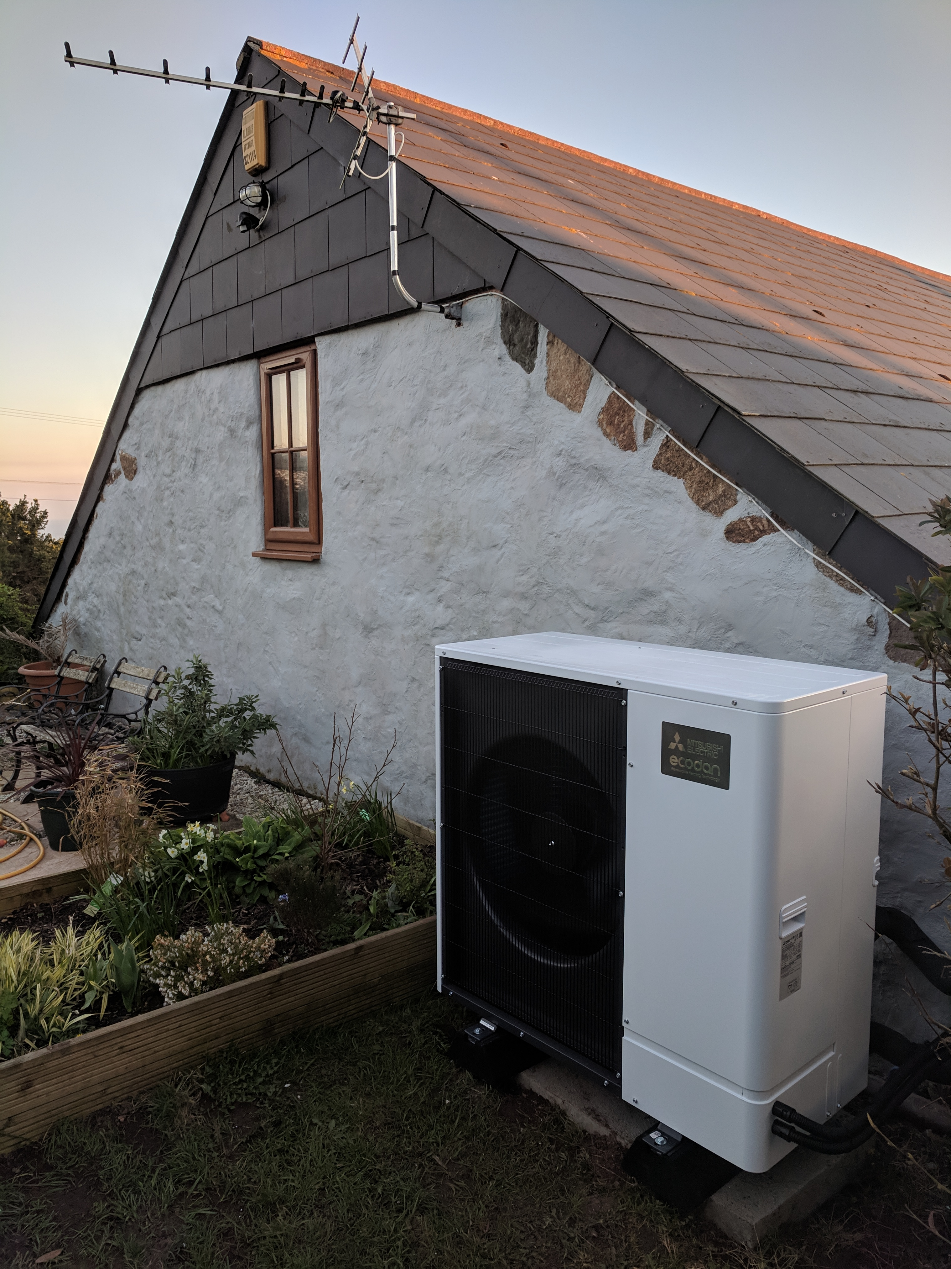 An 11.2kW Ultra Quiet Mitsubishi Ecodan air source heat pump installed by GreenGenUK.