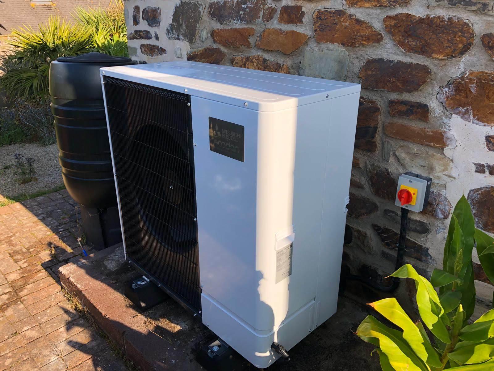 An Ultra Quiet Mitsubishi Ecdodan air source installation.