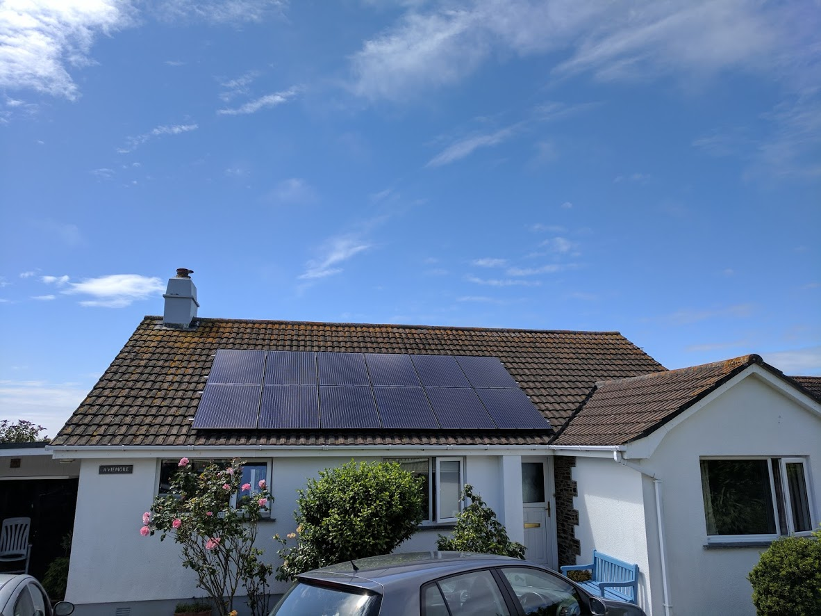 Solar panels installed on a concrete tile bungalow as part of a 3.3kW solar PV installation in Mullion